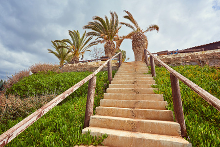 Wooden path down to the beach and ocean. Walkway and stairs through sand dunes and grass. Stock Photo