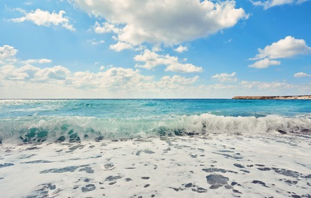 Storming sea and wide-spreading waves, Cyprus coastline. Stock Photo