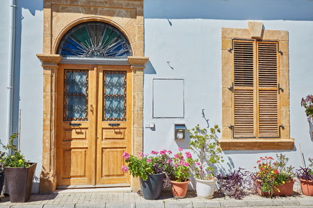 yellow shutters window and door on sidewalk in Cyprus Stok Fotoğraf