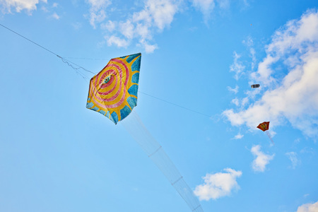 Kite flying in the sky among the clouds Stock Photo