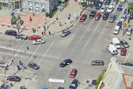 aerial view of cars and people, busy traffic in big intersection.