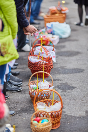 Easter holiday, baskets with festive meals near the church.