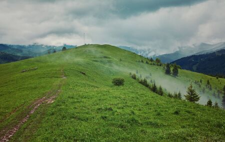Rain clouds on the mountain top. natural landscape.