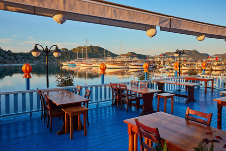 The cozy terrace of local restaurant offers diversity of sea food and turkish cuisine under a cool evening breeze, Kekova, Turkey