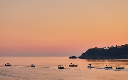 Silhouette of mountains and yachts at sunset, Oludeniz Turkey Stock Photo