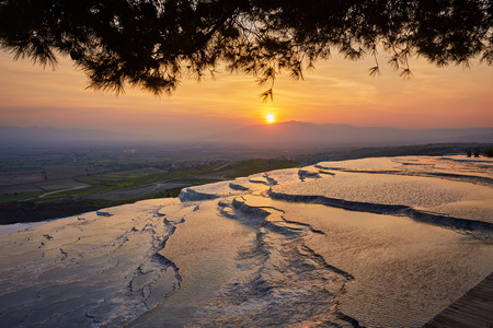 Natural travertine pools and terraces at sunset - Pamukkale, Turkey
