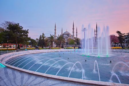 Fountain and The Sultan Ahmed Mosque in Istanbul during sunset
