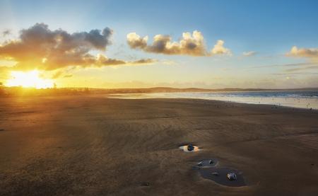 Early morning sunrise over the sea and birds. Morocco, Essaouira Stock Photo