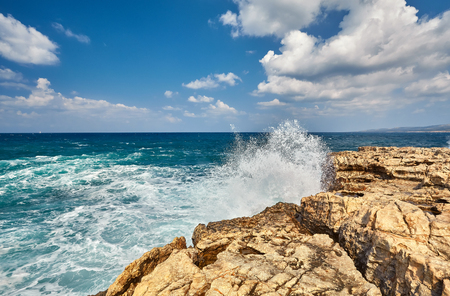 Big waves break about the Rocky Peninsula of Cape Lara in southern Akamas, Cyprus Stok Fotoğraf