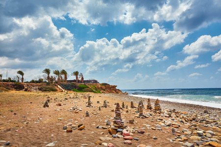 Beautiful wild beach with clear turquoise water and waves. Lara beach, Cyprus. Stock Photo