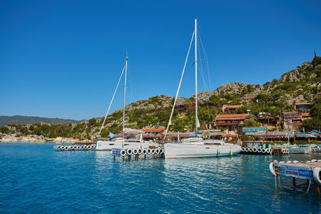ancient city in Kekova and a boat with turkish flag, Antalya, Turkey. Image of summer vacation in Turkey. Stock Photo