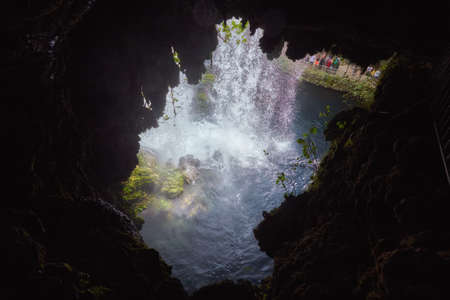 View of the Upper Duden Falls from a cave under a waterfall, Antalya, Turkey