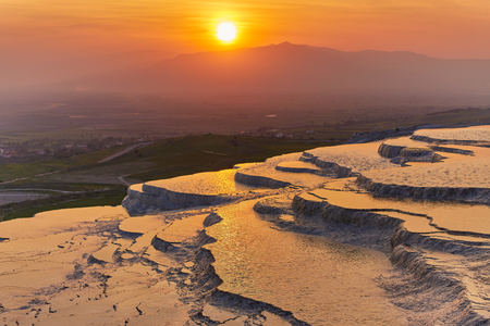 Natural travertine pools and terraces at sunset - Pamukkale, Turkey