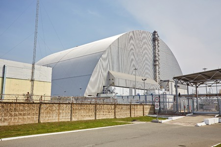 Reactor 4 at the Chernobyl nuclear power plant with a new confinement. Global atomic disaster. Chernobyl Exclusion Zone. Pripyat in the area of the sarcophagus over a blasted nuclear reactor