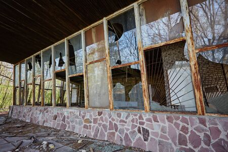 Old broken window. Abandoned building in the city of Pripyat