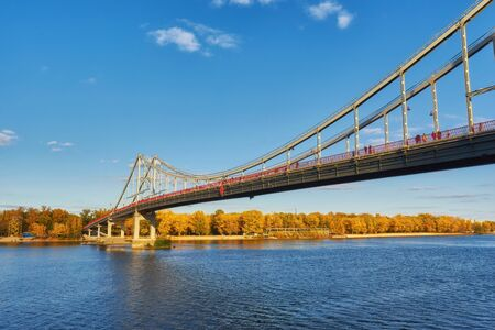 Pedestrian bridge across the Dnieper River, autumn landscape, Kiev, Ukraine