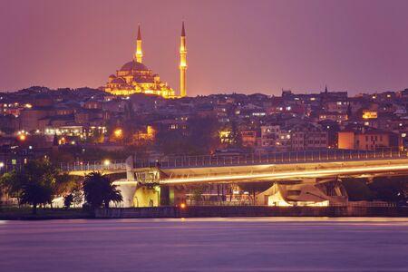 Night view to Suleymaniye Cami, from Galata Bridge, Istanbul, Turkey