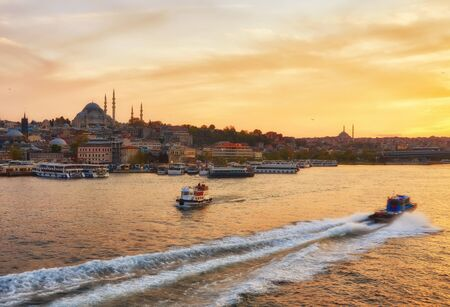 Istanbul at a dramatic sunset with sun Stock Photo