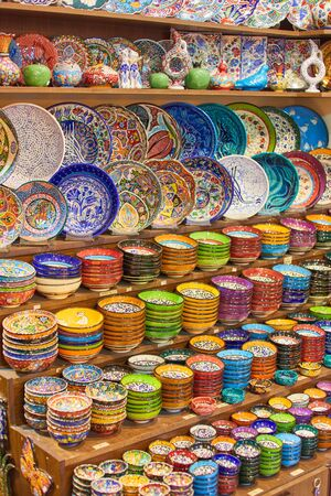 Traditional Turkish colorful ceramics, dishes, bowls, plates, cups, on the souvenir shop of Grand Bazaar. Istanbul, Turkey