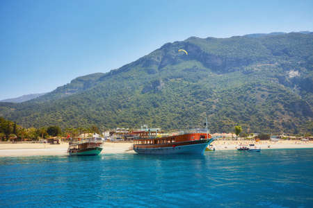 Dead Sea Oludeniz , Situated on Turkey of south-west coast, with it's pristine white beaches and amazingly blue waters, is one of the finest beaches in the world. May 2018, Фото со стока
