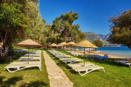 Situated on Turkey of south-west coast, with its pristine white beaches and amazingly blue waters, is one of the finest beaches in the world in Oludeniz, Fethiye. Фото со стока