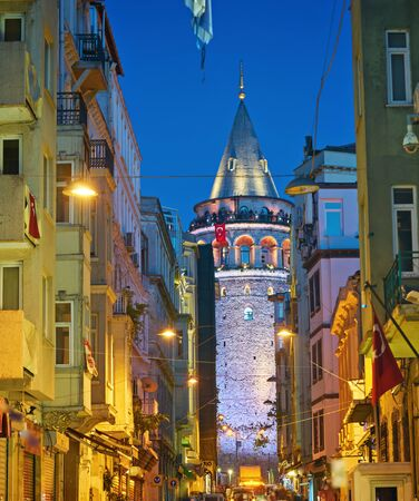 Magnificent night view of Galata Tower, framed by city buildings - Istanbul. Imagens