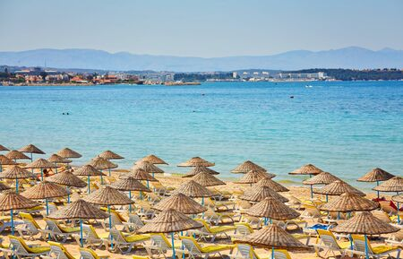 Empty sunbeds on ilica beach by the open sea, Cesme, Turkey 写真素材