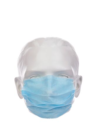 Protective medical mask on a mannequin head. Isolated on a white background