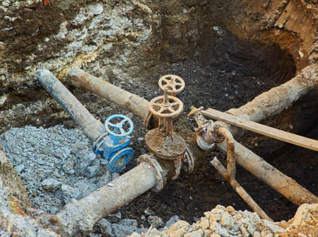 Old city water main taps, a hole dug to repair or replace water supply units