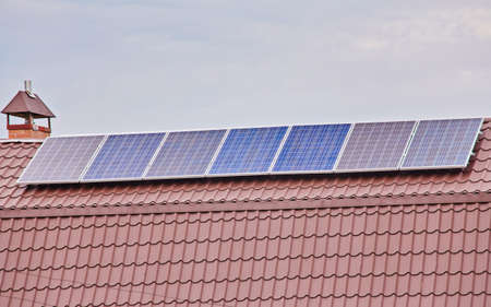 Solar panels on the house roof, environmentally friendly energy from the sun.