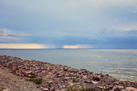 Storm and rain at Dead Sea coastline. Salt crystals at sunset. Texture of Dead sea. Salty sea shore