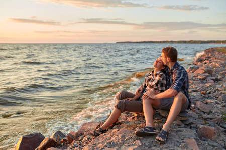 Young couple having fun on a sandy coast 版權商用圖片