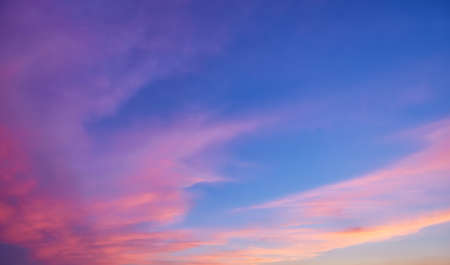 Abstract nature background. Dramatic and moody pink, purple and blue cloudy sunset sky 版權商用圖片