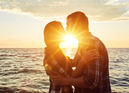 Couple in love silhouette during sunset- touching noses