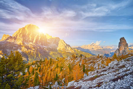 View of Tofane mountains seen from Falzarego pass in an autumn landscape in Dolomites, Italy. Mountains, fir trees and above all larches that change color assuming the typical yellow autumn color 版權商用圖片