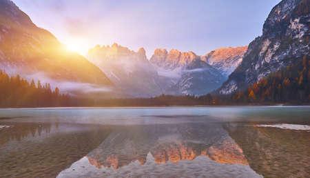 Sunrise at autumn mountain lake. Lago di Landro, Dolomites Alps, Italy 版權商用圖片
