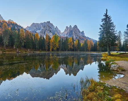 landscape of Antorno lake with famous Dolomites mountain peak of Tre Cime di Lavaredo, Italy Europe.