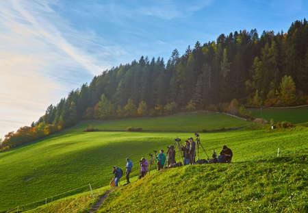 SANTA MADDALENA, ITALY - October 18, 2018: many photographers in village Santa Maddalena Val Di Funes shoots world famous autumn alpine view on Dolomites