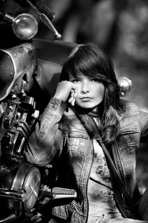 The girl and a motorcycle photo