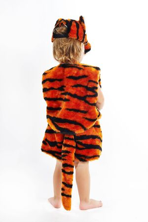 The child in suit of tiger photo