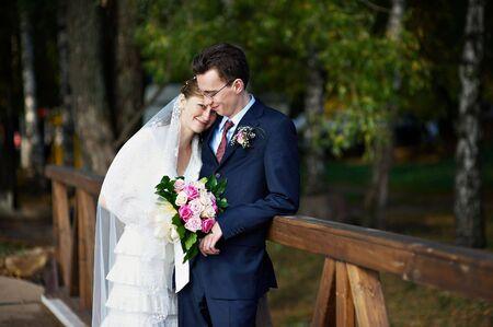 Happy bride and groom on wedding walk photo