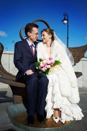 Bride and groom on wedding walk on Luzhkov bridge Stock Photo - 6339045
