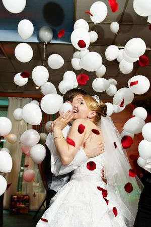 Happy bride and groom in wedding celebration photo