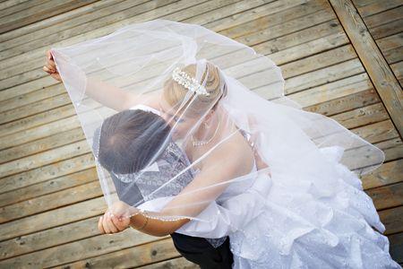 Happy groom and bride on wedding walk  Stock Photo