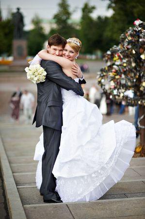 Happy bride and groom at a wedding a walk on bridge Stock Photo