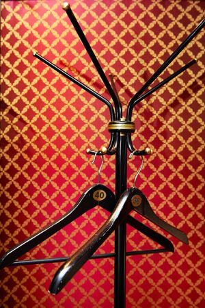 Hanger at the hotel on a red wall photo