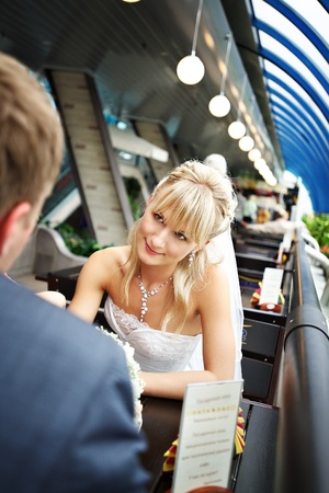 Beautiful Bride at a table in a cafe photo