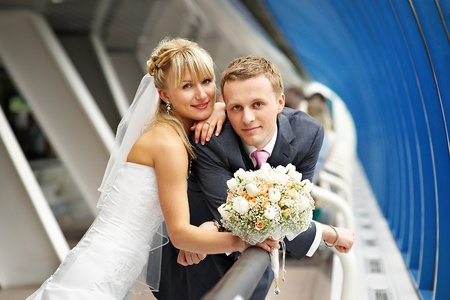 Bride and groom in the interiors of Bridge Business Center Stock Photo