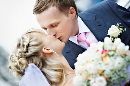 bride groom: Kiss the bride and groom at a wedding Stock Photo