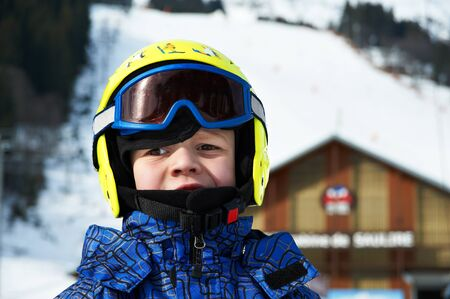 Portrait of child wearing a helmet and glasses mask for skiing Stock Photo - 10605780